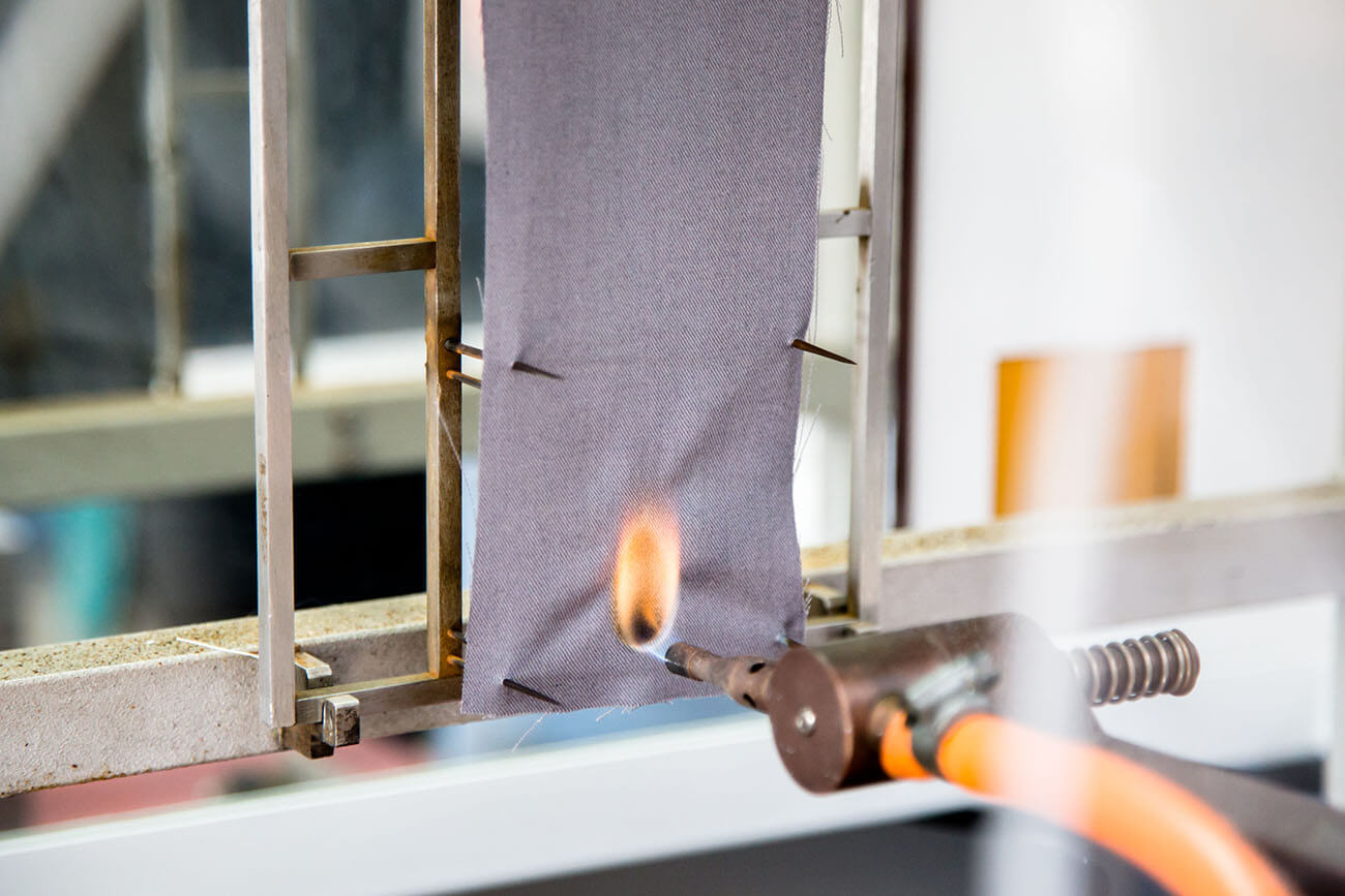 Treated fire resistant fabric